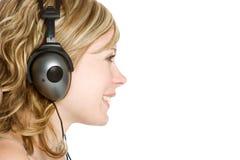 ακουστικά κοριτσιών Στοκ Εικόνα