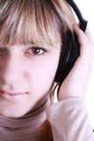 ακουστικά κοριτσιών στοκ φωτογραφία