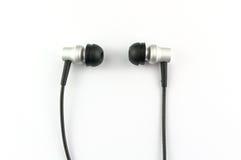Ακουστικά σε ένα άσπρο υπόβαθρο Στοκ φωτογραφία με δικαίωμα ελεύθερης χρήσης