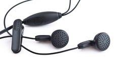 Ακουστικά, garniture από το κινητό τηλέφωνο. Στοκ Φωτογραφίες
