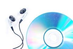 Ακουστικό και το παλαιό CD Στοκ φωτογραφία με δικαίωμα ελεύθερης χρήσης