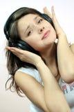 ακουστικό κοριτσιών Στοκ Φωτογραφίες