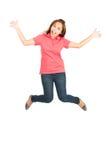 Ακραία ευτυχής πηδώντας μέση ασιατική γυναίκα αέρα που διαδίδεται στοκ εικόνες