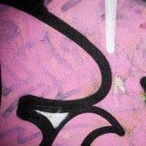 Ακραίος στενός επάνω των γκράφιτι στο συμπαγή τοίχο Στοκ εικόνα με δικαίωμα ελεύθερης χρήσης