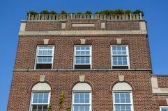 Ακριβά παλαιά σπίτια με τα τεράστια παράθυρα Στοκ Εικόνα