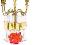 Ακριβός τρόπος ζωής Ποτήρια της σαμπάνιας και της piggy τράπεζας και candel στοκ φωτογραφία