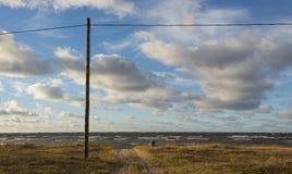Ακτή με τον πόλο Στοκ Φωτογραφίες
