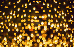 Ακτινοβολήστε ανασκόπηση φω'των Σύσταση διακοπών bokeh μελαχροινοί χρυσός και ο Μαύρος Στοκ φωτογραφία με δικαίωμα ελεύθερης χρήσης