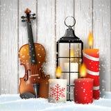 Ακόμα-ζωή Χριστουγέννων με τα κεριά και το βιολί δώρων στοκ φωτογραφίες