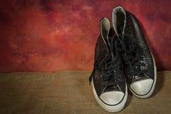 Ακόμα μαύρα παπούτσια ζωής, μπότες Στοκ Φωτογραφία