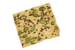 Αλατισμένα μπισκότα με τους σπόρους κάρου του κυμινοειδούς και την κολοκύθα Στοκ Εικόνες