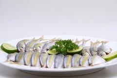 Αλιευμένος μαριναρισμένος στο πιάτο στοκ φωτογραφίες