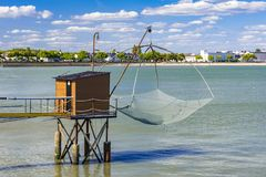 Αλιεύοντας καλύβες και δίχτυα στο ST Nazaire, Γαλλία Στοκ Φωτογραφία