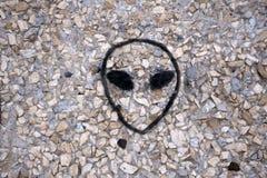 Αλλοδαπό πρόσωπο στον τοίχο ενός UFO Στοκ Εικόνες