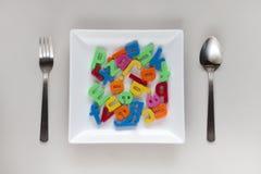 Αλφάβητα σε ένα πιάτο Στοκ εικόνα με δικαίωμα ελεύθερης χρήσης