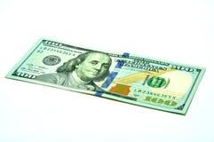 Αμερικανικά 100 ΑΜΕΡΙΚΑΝΙΚΑ δολάρια σε ένα άσπρο υπόβαθρο S Δολάρια Στοκ Φωτογραφία