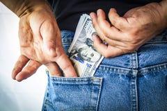 Αμερικανικά δολάρια στην πίσω τσέπη Στοκ Εικόνα