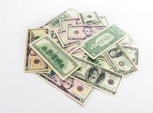 Αμερικανικοί λογαριασμοί τραπεζογραμματίων δολαρίων χρημάτων στο άσπρο υπόβαθρο Στοκ Φωτογραφίες