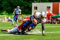 Αμερικανικοί footbal φορείς Στοκ Φωτογραφία