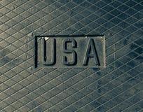 ΑΜΕΡΙΚΑΝΙΚΟ σημάδι, λογότυπο που χαράσσεται στο μέταλλο, χάλυβας Μεταλλικό λογότυπο Στοκ Φωτογραφίες