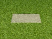 Αμμοχάλικο και χλόη: τετραγωνικό μπάλωμα και πράσινο πλαίσιο στοκ εικόνες