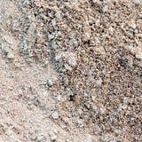 Αμμοχάλικο με την άμμο ως υπόβαθρο στοκ εικόνα με δικαίωμα ελεύθερης χρήσης