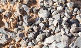 Αμμοχάλικο με την άμμο ως υπόβαθρο στοκ εικόνα