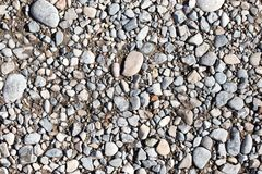 Αμμοχάλικο στο δρόμο ως υπόβαθρο σύσταση στοκ φωτογραφίες