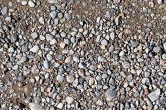 Αμμοχάλικο στο δρόμο ως υπόβαθρο σύσταση στοκ εικόνα