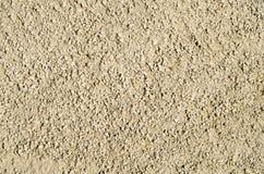 Αμμοχάλικο που αναμιγνύεται με την κινηματογράφηση σε πρώτο πλάνο άμμου Στοκ Εικόνες