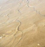 Αμμόλοφος Μαρόκο της Αφρικής στην καφετιά παραλία άμμου ακτών υγρή κοντά σε atlan Στοκ Φωτογραφίες