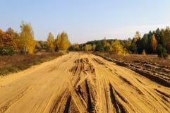 Αμμώδης δρόμος στη χώρα, χρόνος φθινοπώρου Στοκ Εικόνες