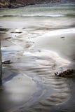 αμμώδης παλίρροια παραλιώ&n Στοκ φωτογραφία με δικαίωμα ελεύθερης χρήσης