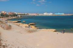 Αμμώδης παραλία στην ακτή του κόλπου θάλασσας Πόρτο-Torres, Ιταλία Στοκ Φωτογραφίες
