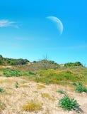 Αμμώδη ακτή και φεγγάρι Στοκ Εικόνες