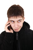 Αμφισβητήσιμος έφηβος με το κινητό τηλέφωνο Στοκ εικόνα με δικαίωμα ελεύθερης χρήσης