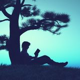 Ανάγνωση κάτω από ένα δέντρο απεικόνιση αποθεμάτων