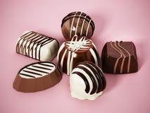 Ανάμεικτες σοκολάτες στο ρόδινο υπόβαθρο τρισδιάστατη απεικόνιση απεικόνιση αποθεμάτων