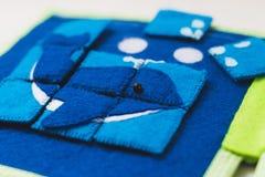 Ανάπτυξη του γρίφου παιχνιδιών υφάσματος Στοκ Φωτογραφία