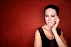 ανήσυχη κόκκινη γυναίκα α&nu Στοκ φωτογραφία με δικαίωμα ελεύθερης χρήσης