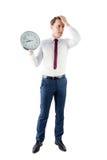 Ανήσυχος επιχειρηματίας που κρατά ένα ρολόι Στοκ εικόνες με δικαίωμα ελεύθερης χρήσης