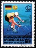 Αναβάτης Gregor Braun ποδηλάτων της Γερμανίας, από τους Ολυμπιακούς Αγώνες σειράς `, Μόντρεαλ - νικητές `, circa 1976 χρυσών μετα Στοκ Φωτογραφία