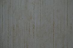 Αναδρομικά γκρίζα κατασκευασμένα κάθετα λωρίδες υποβάθρου ταπετσαριών Στοκ Εικόνες