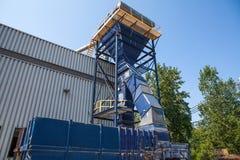 Ανακύκλωση της μηχανής έξω από την κατασκευή στη διαδικασία Στοκ Φωτογραφίες