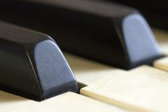 Αναμονή πιάνων που παίζεται επάνω Στοκ Εικόνες