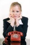 Αναμονή τηλεφωνικώς στοκ φωτογραφία