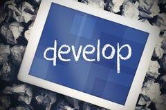 Αναπτυχθείτε ενάντια στο PC ταμπλετών με την μπλε οθόνη στοκ εικόνα με δικαίωμα ελεύθερης χρήσης