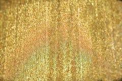 ανασκόπησης όμορφα υφάσματος χρυσά φωτεινά κύματα σκιών σατέν satiny Στοκ Φωτογραφία