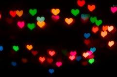 Ανασκόπηση ημέρας βαλεντίνου με τη defocusing καρδιά θαμπάδων bokeh Στοκ εικόνα με δικαίωμα ελεύθερης χρήσης