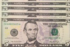 Ανασκόπηση με τα χρήματα ΗΠΑ λογαριασμοί 5 δολαρίων Στοκ φωτογραφία με δικαίωμα ελεύθερης χρήσης
